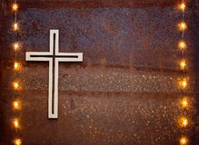 Wooden crucifix on rusty iron Stock Photos