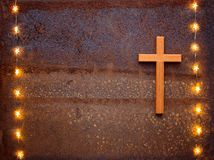 Wooden crucifix on rusty iron Stock Image