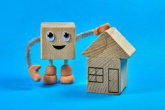 Wooden cube as a character and real estate Stock Photo