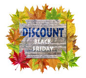 Wooden cube with autumn leaf around and word Black Friday Discount Stock Image