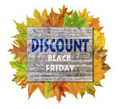 Wooden cube with autumn leaf around and word Black Friday Discount Royalty Free Stock Images