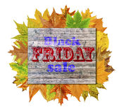 Wooden cube with autumn leaves around and word Black Friday Sale Royalty Free Stock Image