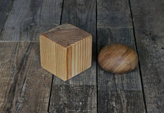 Wooden cube and the ball Stock Images