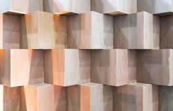 Wooden cube boxes creating abstract geometric wall Stock Images