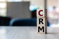 Wooden cube with CRM text Customer Relationship Management on table background. Financial, marketing and business concepts. Wooden cube with CRM text Customer royalty free stock images