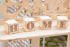 Wooden cube decoration: home letters Royalty Free Stock Photo