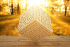Wooden cube with engrave maze Royalty Free Stock Photography