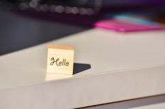 Wooden cube with hand written inscription Hello Stock Image