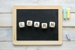 Wooden cube letters, forming the word LEARN Stock Photo