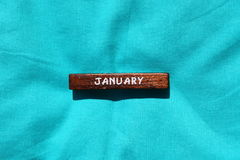 Wooden cube with the name of the month. January Stock Photography