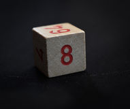 Wooden cube with the number eight Royalty Free Stock Photo