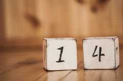 Wooden cube with the number Stock Photo