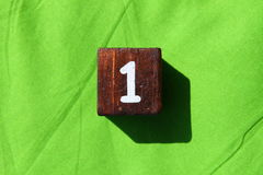Wooden cube with the number one Royalty Free Stock Photo
