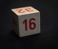 Wooden cube with the number sixteen Stock Image