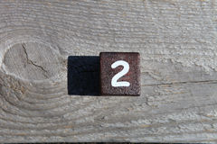 Wooden cube with the number two Royalty Free Stock Images