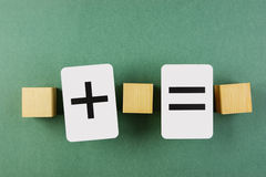 Wooden cube and school card math problems Royalty Free Stock Images