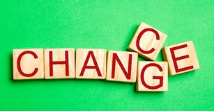 Wooden cube with word `change` to `chance` on wood table. Personal development and career growth or change yourself concept. conce. Pt of motivation, goal stock photo
