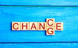 Wooden cube with word `change` to `chance` on wood table. Personal development and career growth or change yourself concept. conce royalty free stock photography