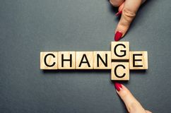 Wooden cube with word change to chance on wood table. Personal development and career growth or change yourself concept. concept stock photos
