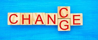 Wooden cube with word `change` to `chance` on wood table. Personal development and career growth or change yourself concept. conce stock images