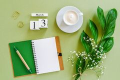 Free Wooden Cubes Calendar March 13. Notepad, Cup Of Coffee, Bouquet Flowers On Green Background. Concept Hello Spring Top View Flat Stock Photos - 172670293