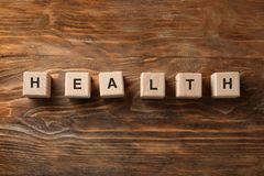 Wooden cubes composed word HEALTH on table royalty free stock photography
