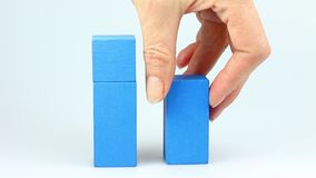 Wooden cubes decrease concept stock video footage