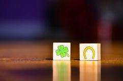 Wooden cubes with a fortune symbol Four Leaf Clover and a  horseshoe Stock Photography