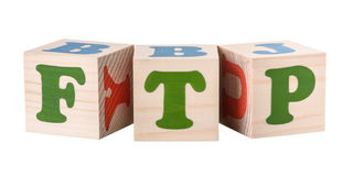 Wooden cubes. FTP word. Isolated on a white background royalty free stock images