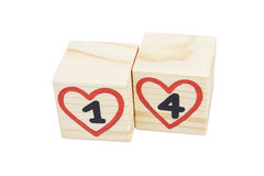 Wooden cubes with handwritten 14th and red hearts. Isolated. Wooden cubes with handwritten 14th and red hearts. Isolated on a white background Stock Photos