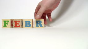 Wooden cubes. Months of the year. February stock footage