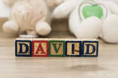 Wooden cubes with the name David. Wooden cubes with the name in different colors stock photography