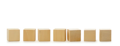 Wooden cubes in row Royalty Free Stock Photography