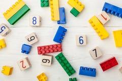 Wooden cubes and toy bricks. Child toys baby background block boy brick stock photos