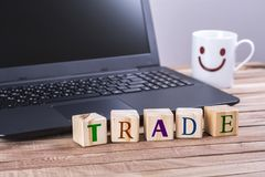Wooden cubes trade word Stock Photo