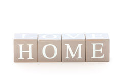 Wooden cubes wit the word home spelled Stock Photo