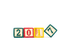 Wooden cubes withnew year  2017 on white background Stock Photography