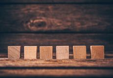 Wooden Cubes on Wood Background royalty free stock photography