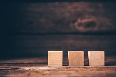 Wooden Cubes on Wood Background royalty free stock image