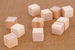 Wooden cubes. On brown bamboo background Royalty Free Stock Photos