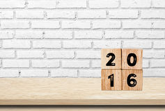 Wooden cubes with 2016 on wooden table background Stock Photos