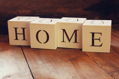 Wooden cubes with the writing home over wooden table. Royalty Free Stock Photography