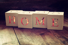 Wooden cubes with the writing home over wooden table. Royalty Free Stock Photo