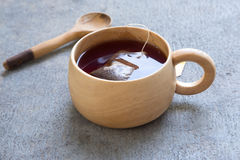 Wooden cup with a bag of tea Stock Photos