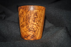 Wooden cup on blak stock images