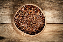 Wooden cup with coffee-beans Stock Photo