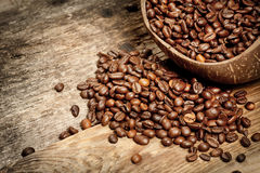 Wooden cup with coffee-beans Stock Photography