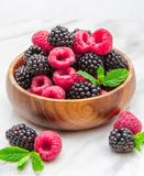 Wooden cup with fresh berries Royalty Free Stock Photos