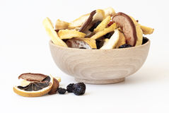 A wooden cup full of dried fruits Royalty Free Stock Photography