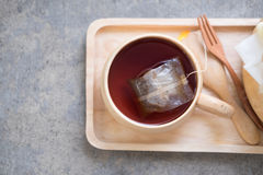 Wooden cup of hot tea Royalty Free Stock Photos